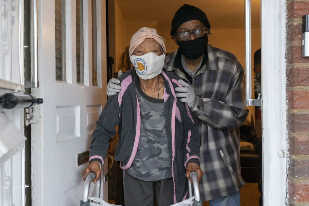 In this Wednesday, Feb. 10, 2021, photo Melvin Marriott, 69, poses for a photograph with his 93-year-old mother, at the home they share in southeast W...