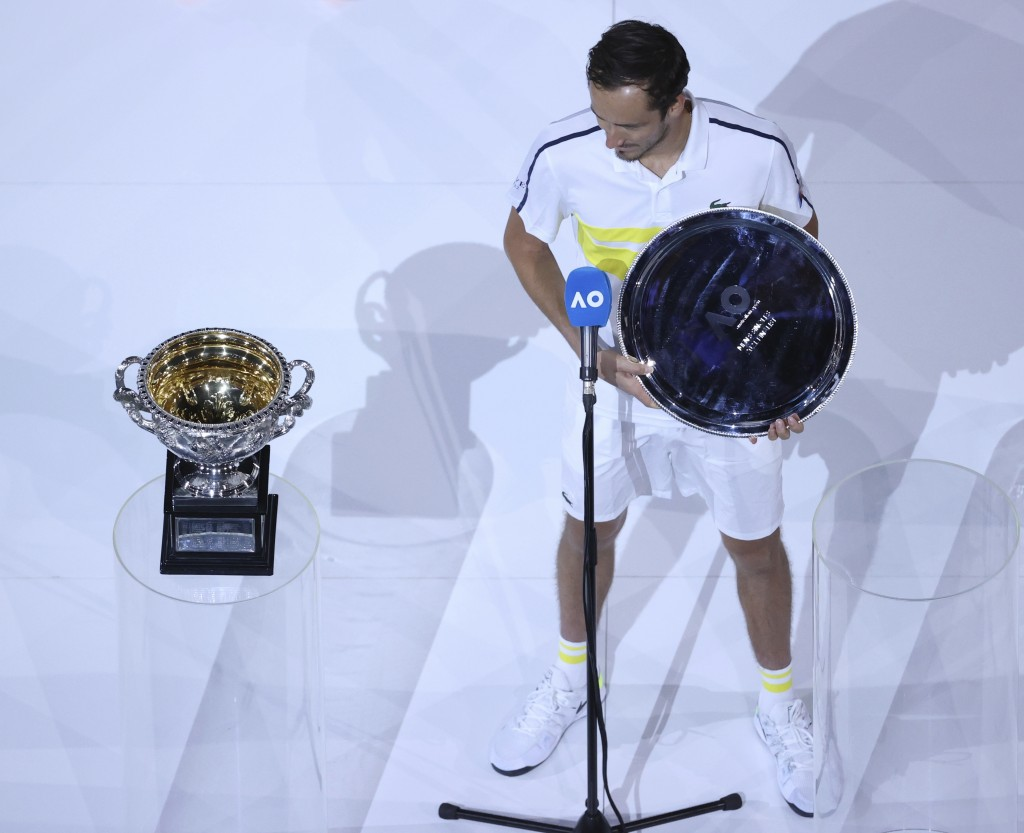 Russia's Daniil Medvedev holds his runners' up trophy after losing to Serbia's Novak Djokovic in the men's singles final at the Australian Open tennis...