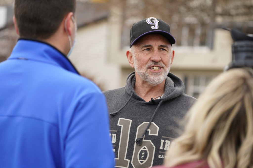 Kirby Klements talks about a piece of debris that crushed his pickup truck parked next to his home in Broomfield, Colo., as the plane shed parts while...