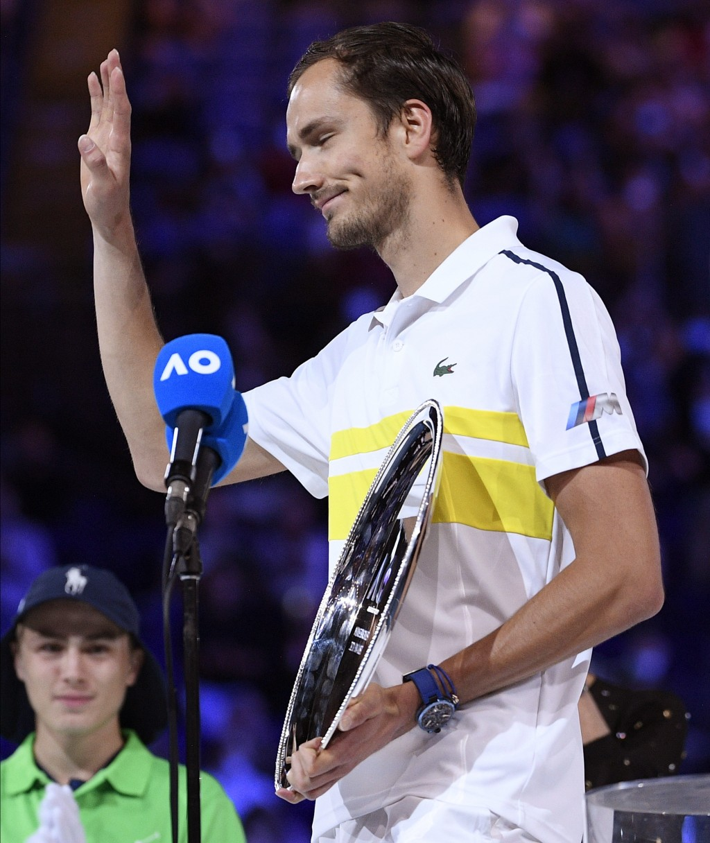 Russia's Daniil Medvedev waves after receiving his trophy for runner-up after losing to Serbia's Novak Djokovic in the men's singles final at the Aust...