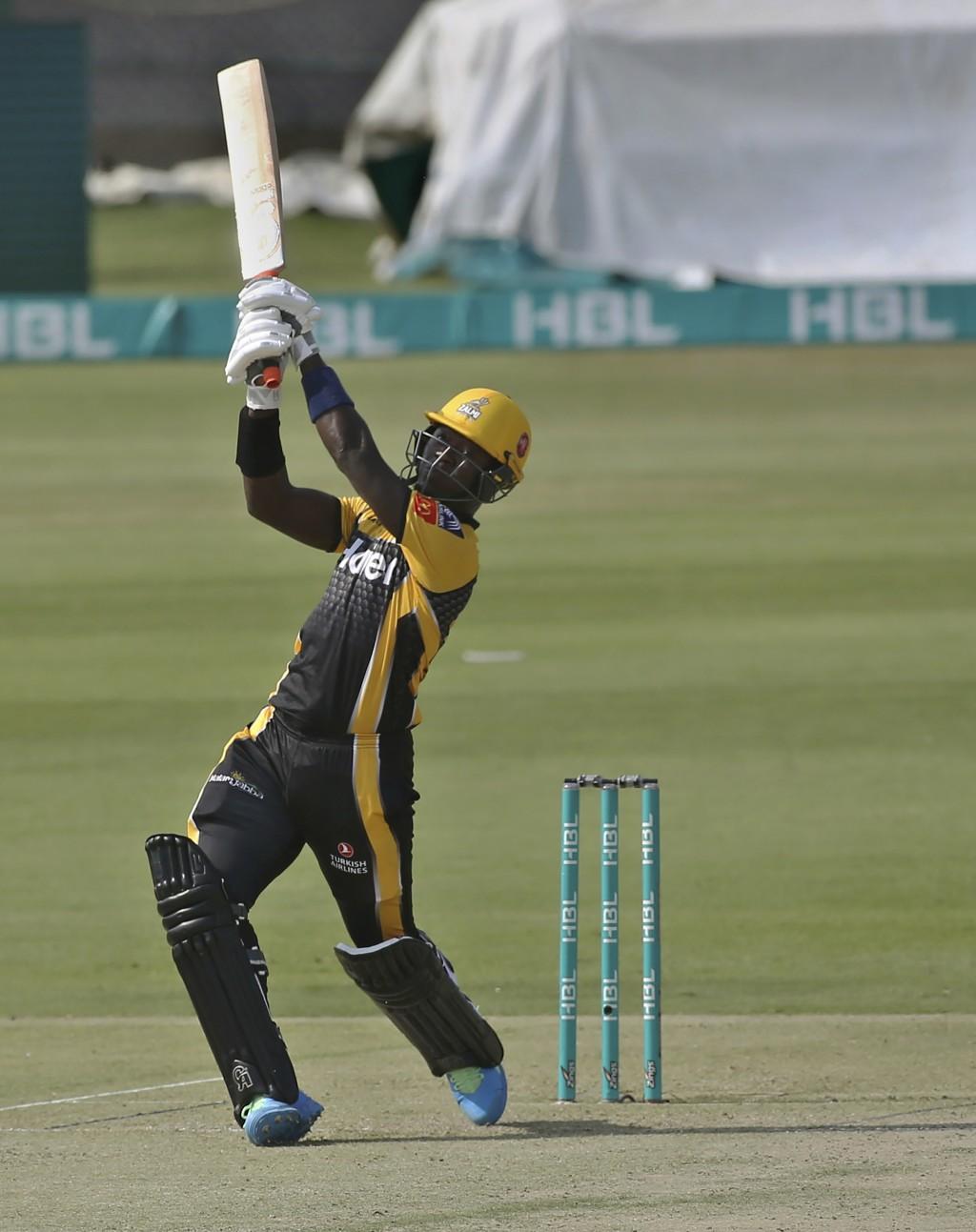 Peshawar Zalmi's Sherfane Rutherford plays a shot for boundary during a Pakistan Super League T20 cricket match between Peshawar Zalmi and Lahore Qala...