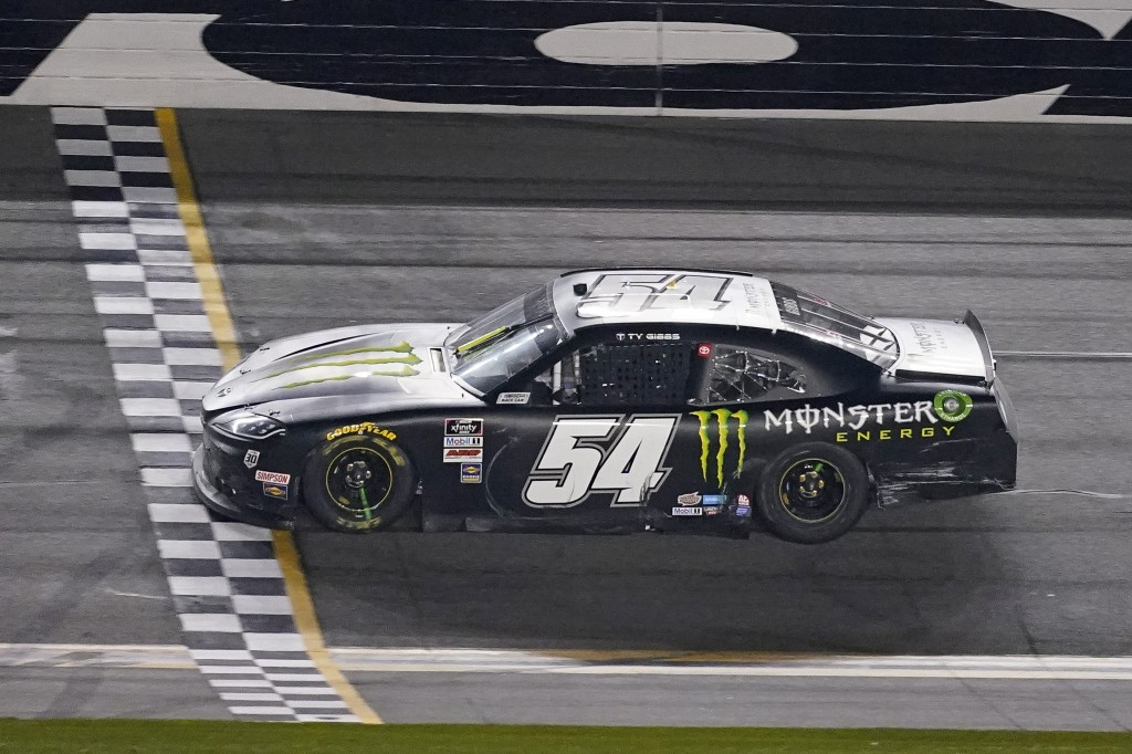 Ty Gibbs (54) crosses the finish line to win the NASCAR Xfinity Series road course auto race at Daytona International Speedway, Saturday, Feb. 20, 202...