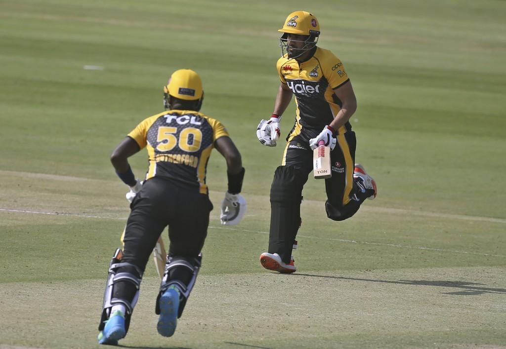 Peshawar Zalmi's Ravi Bopara, right, and Sherfane Rutherford run between the wickets during a Pakistan Super League T20 cricket match between Peshawar...
