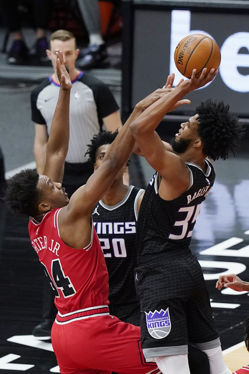 Sacramento Kings forward Marvin Bagley III, right, shoots over Chicago Bulls center Wendell Carter Jr., during the first half of an NBA basketball gam...