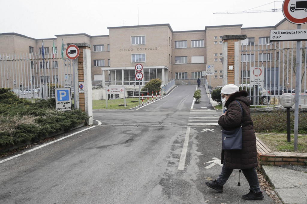 A woman walks in front of the Civic Hospital in Codogno, northern Italy, Sunday, Feb. 21, 2021. The first case of locally spread COVID-19 in Europe wa...
