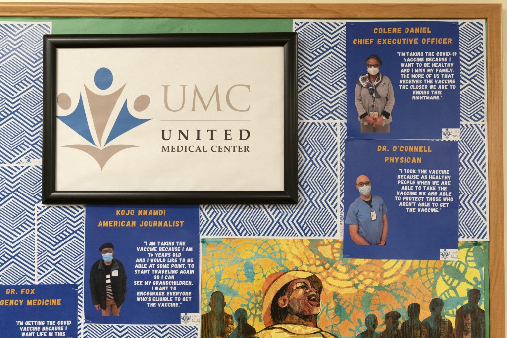 This Wednesday, Feb. 10, 2021, photo shows photographs and quotes from people who have received the COVID-19 vaccination at United Medical Center in s...
