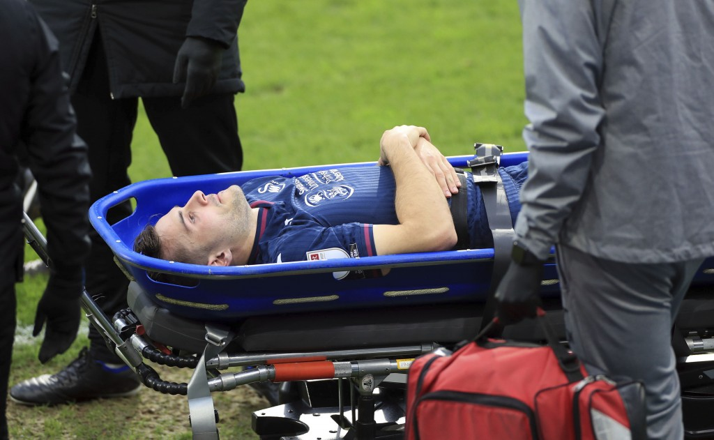 Swansea City's Jordan Morris is stretchered off the field after getting hurt during a Sky Bet Championship soccer match against Huddersfield, Saturday...