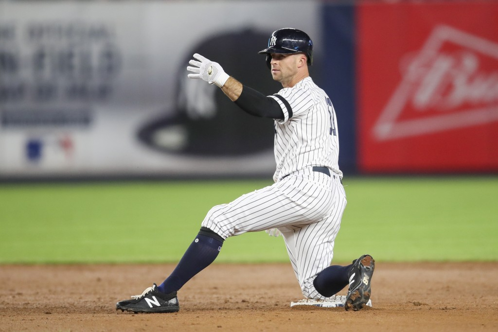 FILE - In this Sept. 19, 2019, file photo, New York Yankees' Brett Gardner gestures from second base after hitting an RBI double during the sixth inni...