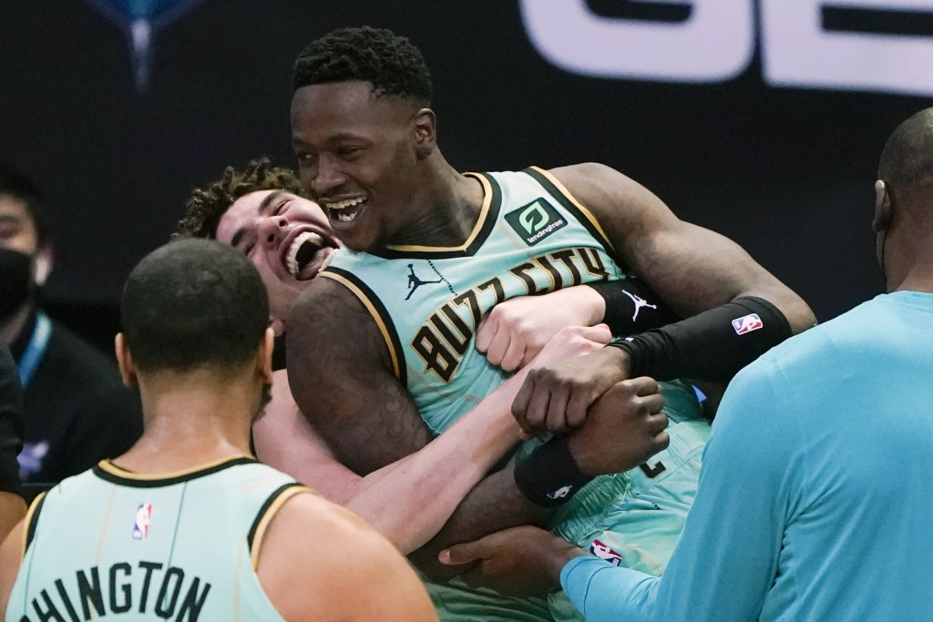 Charlotte Hornets guard Terry Rozier celebrates after scoring the game winning basket with LaMelo Ball, left, against the Golden State Warriors during...