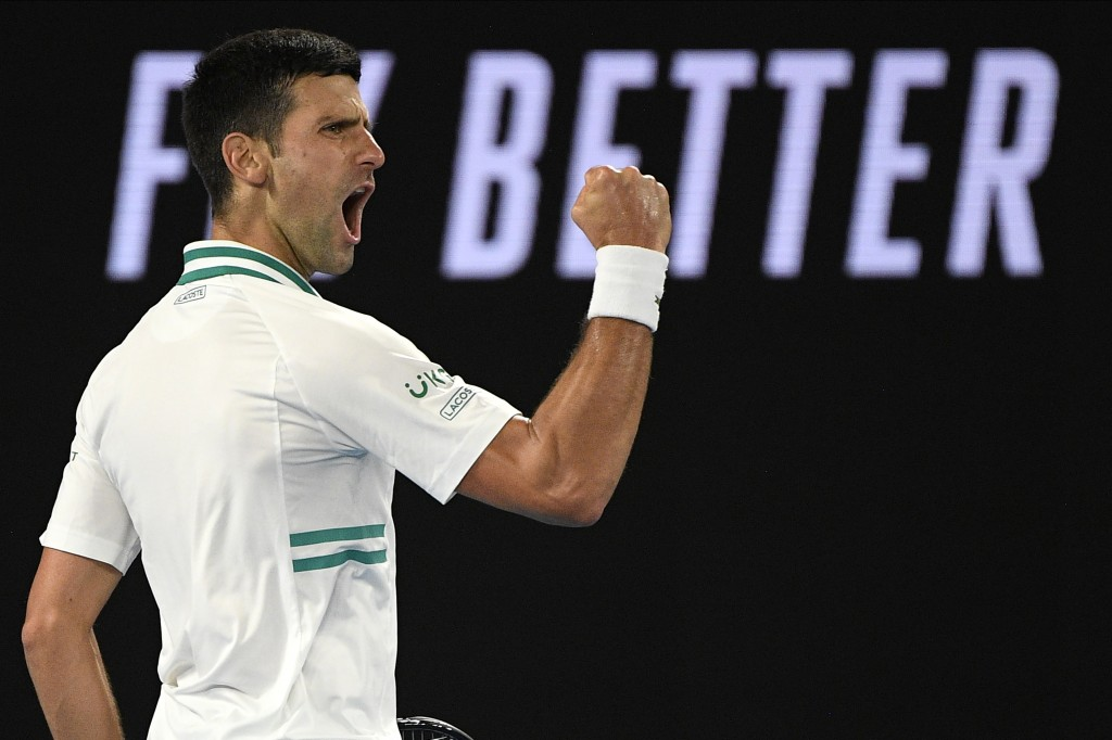 Serbia's Novak Djokovic reacts after winning a point against Russia's Daniil Medvedev in the men's singles final at the Australian Open tennis champio...