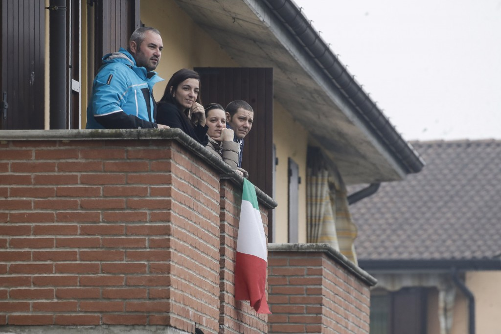 People follow the unveiling of a memorial for Covid deaths in Codogno, northern Italy, Sunday, Feb. 21, 2021. The first case of locally spread COVID-1...