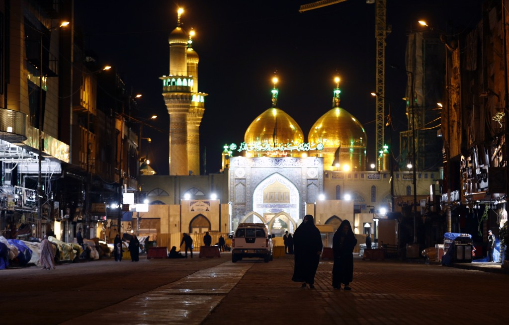 Shiite faithful pilgrims visit the shrine of Imam Moussa al-Kadhim in Baghdad, Iraq, despite a curfew imposed by the government to help fight the spre...