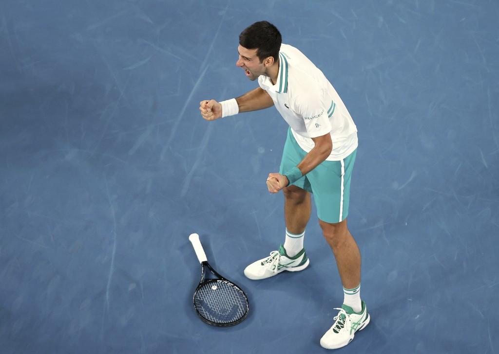 Serbia's Novak Djokovic celebrates after defeating Russia's Daniil Medvedev in the men's singles final at the Australian Open tennis championship in M...