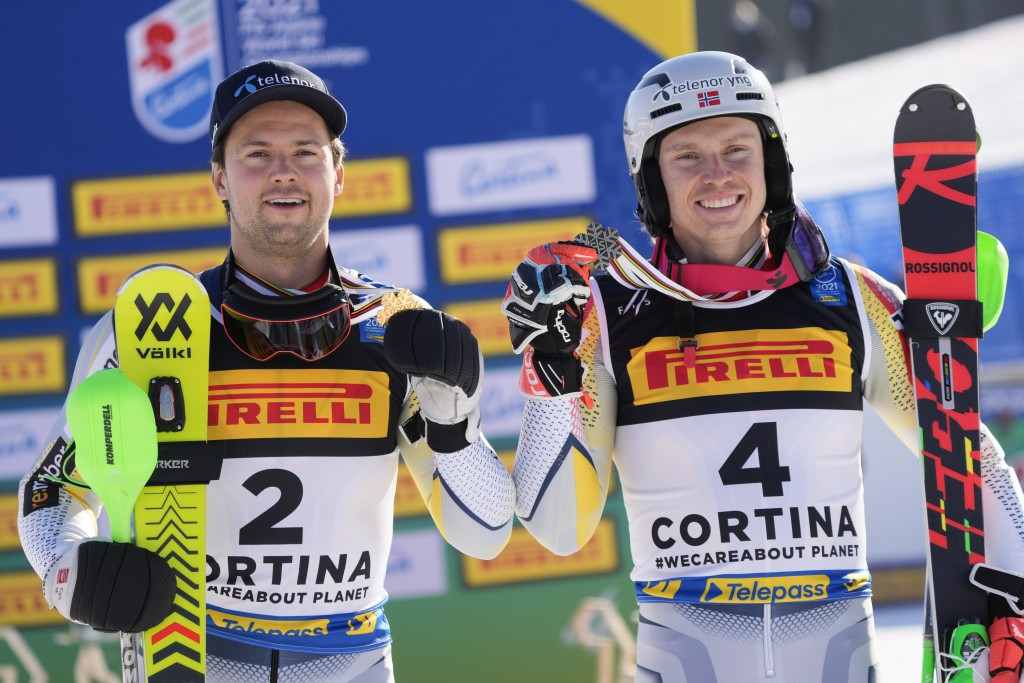 Norway's Sebastian Foss Solevaag, left, winner of the men's slalom, and third-placed Norway's Henrik Kristoffersen, show their respective gold and bro...