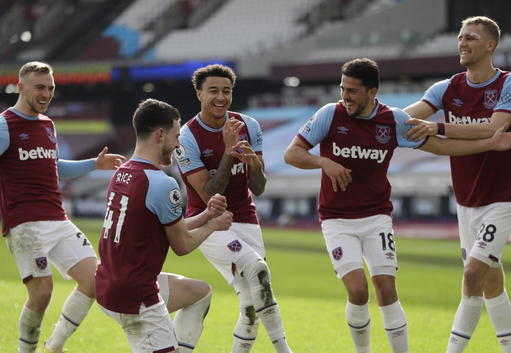 CORRECTS SPELLING OF NAME     West Ham's Jesse Lingard, centre, celebrates with teammates after scoring his side's second goal during the English Prem...