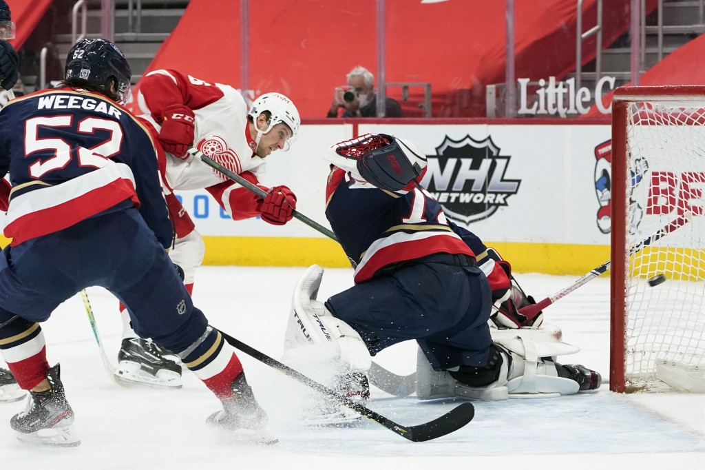 Detroit Red Wings left wing Mathias Brome (86) scores on Florida Panthers goaltender Sergei Bobrovsky (72) in the second period of an NHL hockey game ...