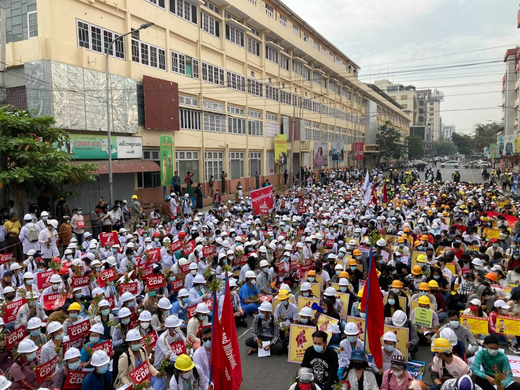 Medical students gather during an anti-coup protest in Mandalay, Myanmar, Sunday, Feb. 21, 2021. Riot police in Myanmar shot dead at least a few anti-...