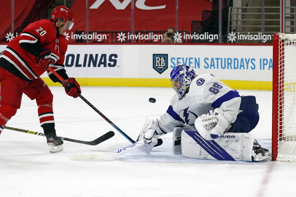 Carolina Hurricanes Sebastian Aho (20) shoots the puck past Tampa Bay Lightning goaltender Andrei Vasilevskiy (88) for a goal during the second period...