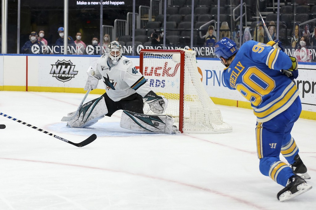 St. Louis Blues' Ryan O'Reilly (90) scores a goal against San Jose Sharks' goaltender Devan Dubnyk (40) during the second period of an NHL hockey game...