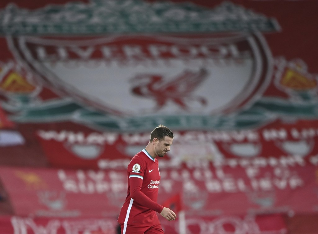Liverpool's Jordan Henderson walks from the pitch as he is substituted for an injury during the English Premier League soccer match between Liverpool ...