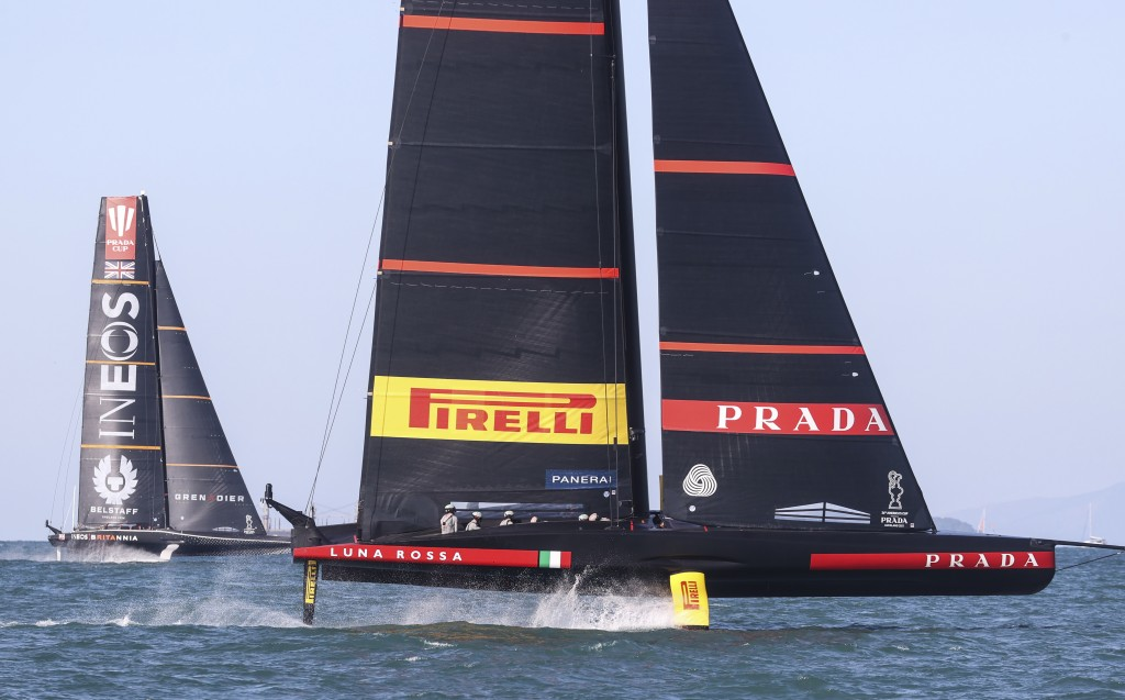 Italy's Luna Rossa, right, leads Britain's INEOS Team UK in race eight of the Prada Cup on Auckland's Waitemata Harbour, New Zealand, Sunday, Feb.21, ...