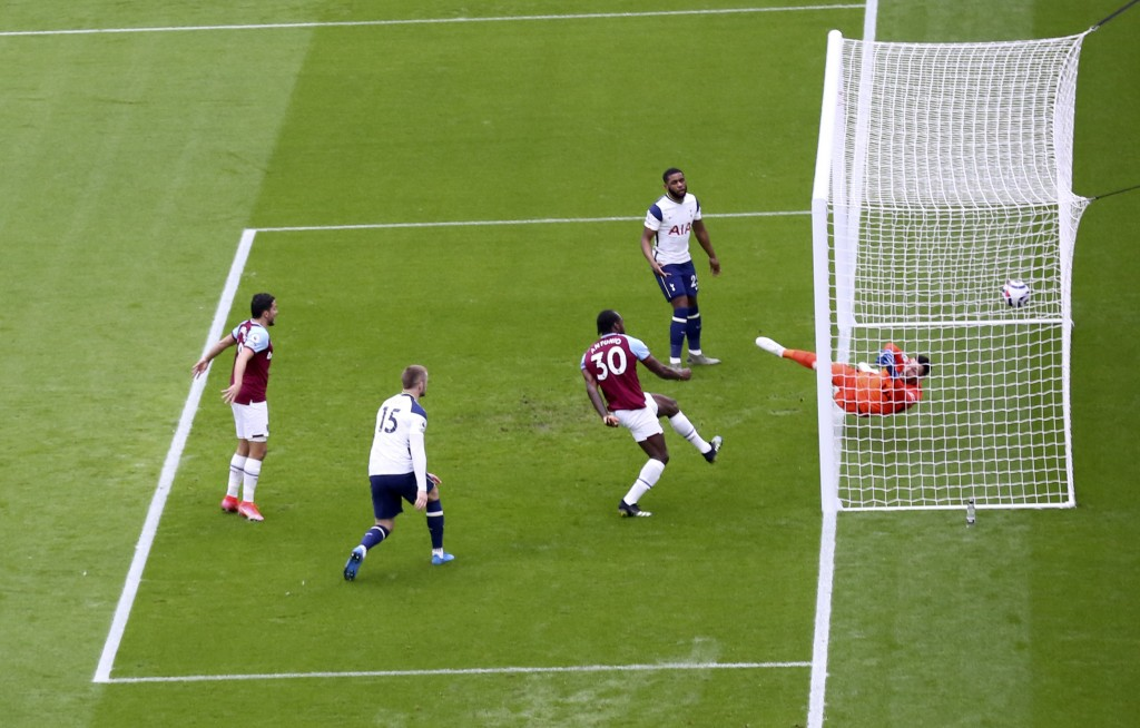 West Ham's Michail Antonio, third left, scores his side's opening goal during the English Premier League soccer match between West Ham United and Tott...