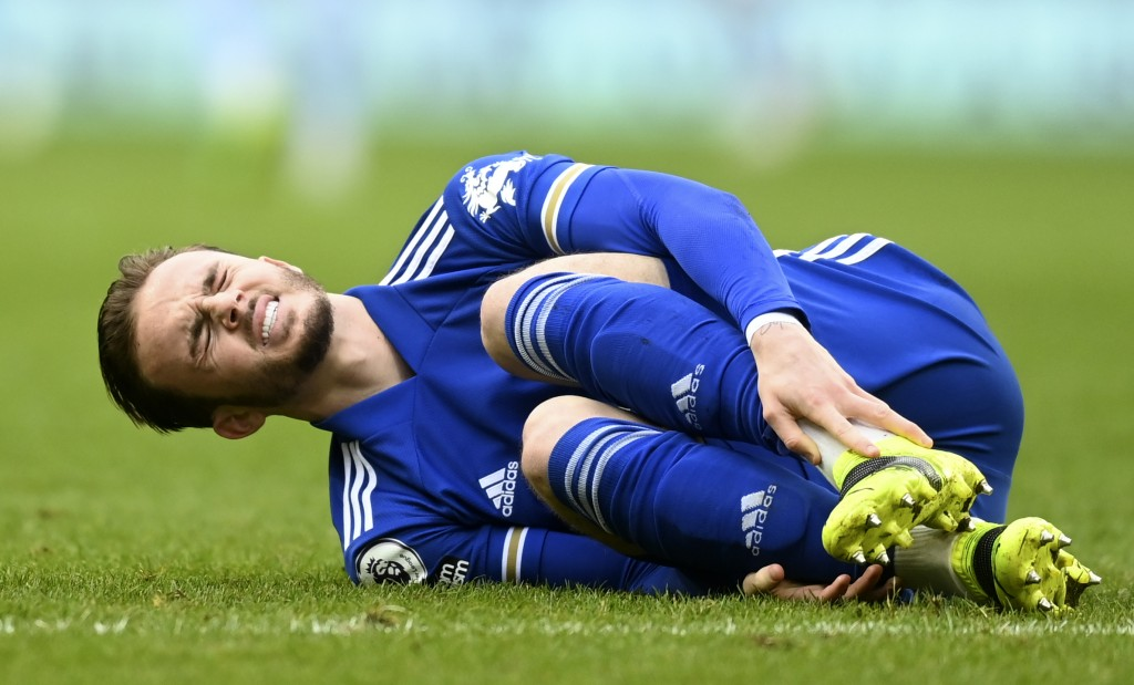 Leicester's James Maddison grimaces after suffering an injury during the English Premier League soccer match between Aston Villa and Leicester City at...