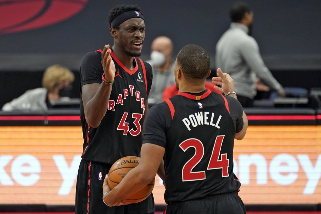 Toronto Raptors forward Pascal Siakam (43) celebrates with guard Norman Powell (24) after the team defeated the Philadelphia 76ers during an NBA baske...