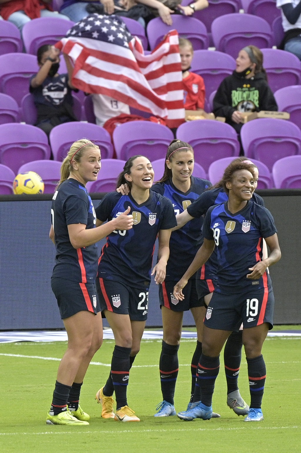 The United States forward Christen Press, second from left, is congratulated by teammates Lindsey Horan, left, Alex Morgan, and Crystal Dunn (19) afte...