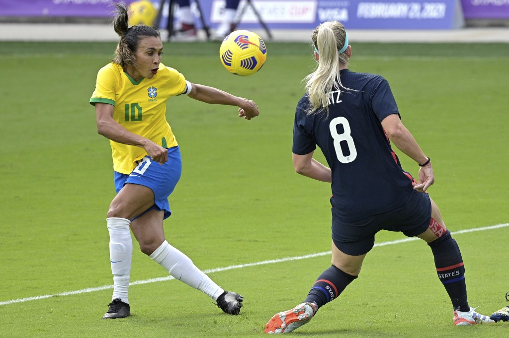 United States midfielder Julie Ertz (8) blocks a shot on goal by Brazil midfielder Marta (10) during the first half of a SheBelieves Cup women's socce...
