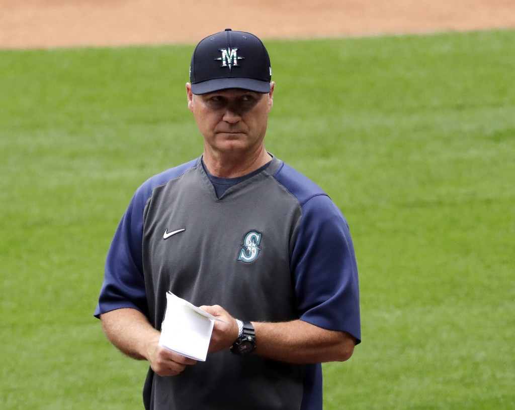 """FILE - In this July 3, 2020, file photo, Seattle Mariners manager Scott Servais walks on the field at a """"summer camp"""" baseball workout on their ballpa..."""