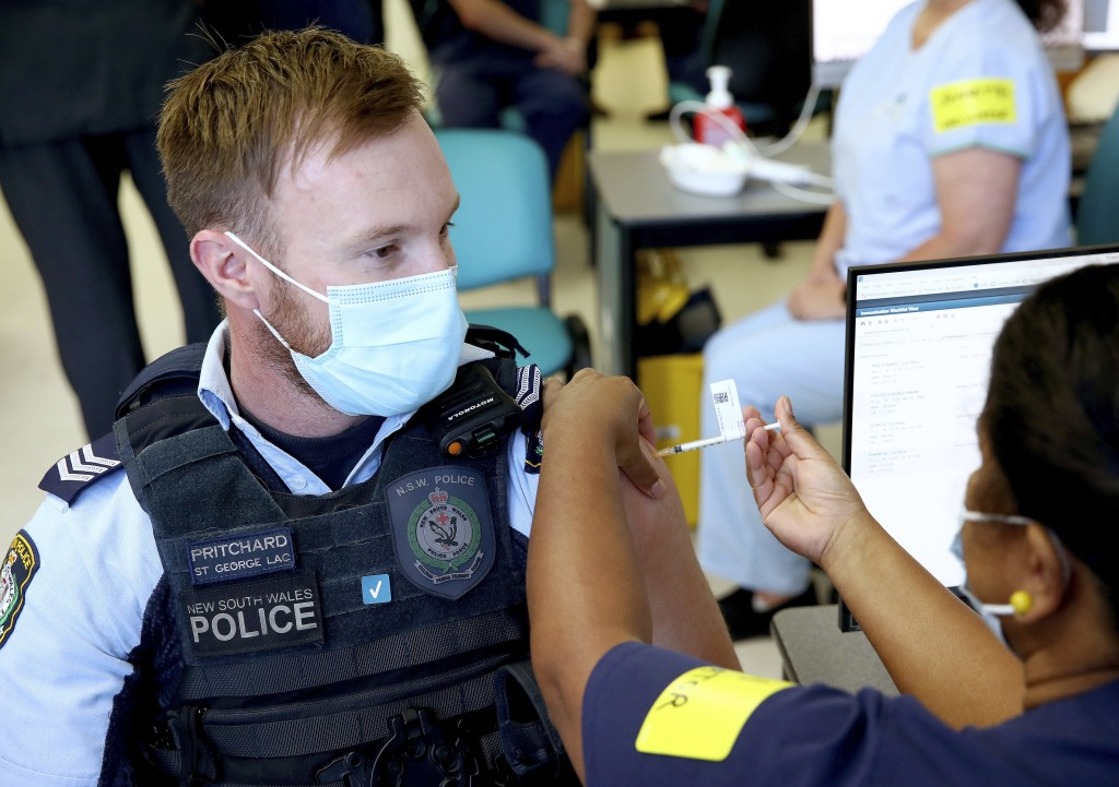 New South Wales Police officer Lachlan Pritchard receives the Pfizer vaccine at the Royal Prince Alfred Hospital Vaccination Hub in Sydney, Australia,...
