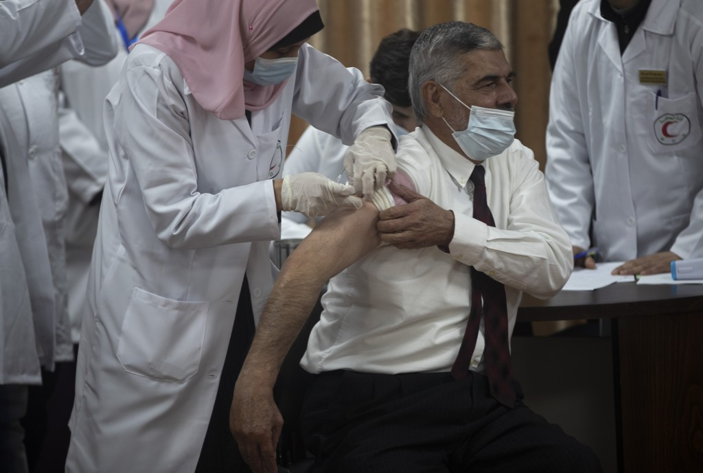 Palestinian Health Ministry official Yahya Aabed, receives a shot of the COVID-19 Russian-made Sputnik V vaccine, in Gaza City, Monday, Feb. 22, 2021....