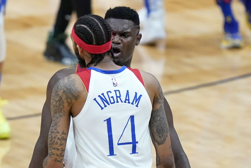 New Orleans Pelicans forward Zion Williamson, right, celebrates with forward Brandon Ingram (14) in the second half of an NBA basketball game against ...