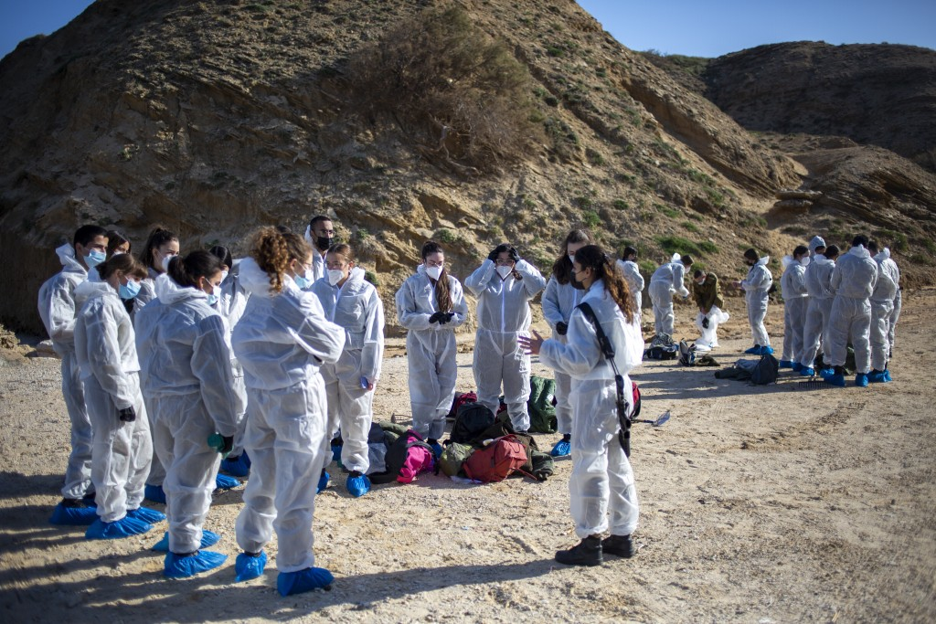 Israeli soldiers wearing protective suits listen to a briefing ahead of cleanup operations to remove tar from a beach after an oil spill in the Medite...