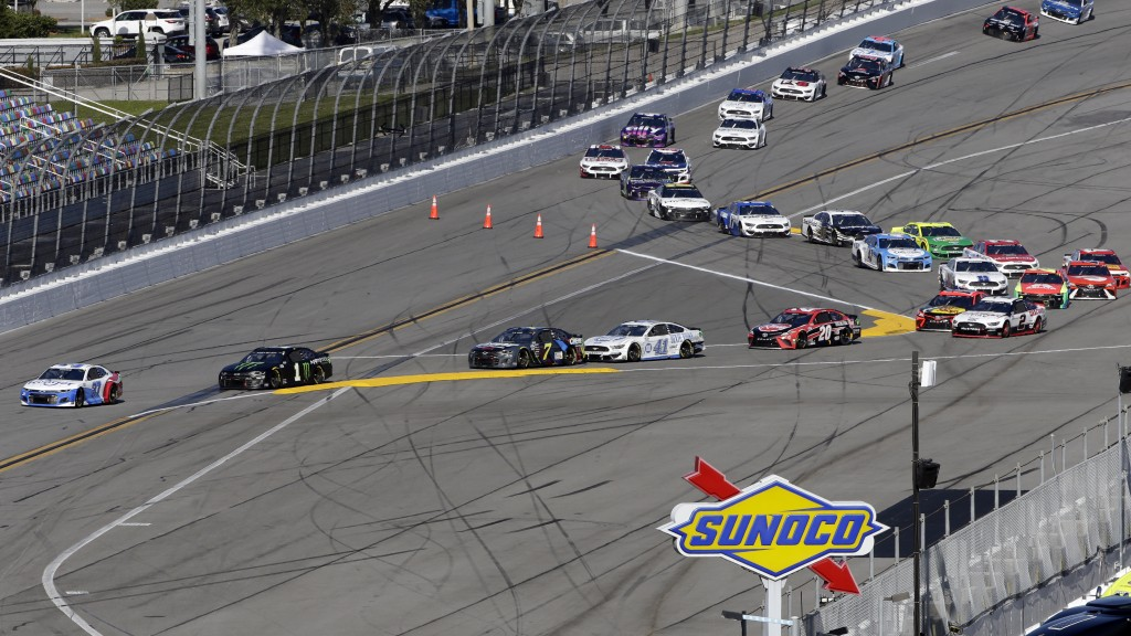Ryan Preece (37) and Kurt Busch (1) lead a field of cars through a turn before heading to the front stretch during the NASCAR Cup Series road-course a...