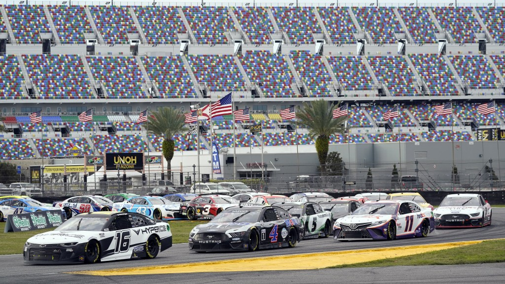 AJ Allmendinger (16) and Kevin Harvick (4) lead the field during a restart on lap 29 of the NASCAR Cup Series road-course auto race at Daytona Interna...
