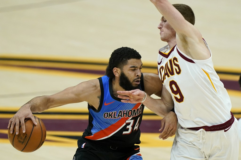 Oklahoma City Thunder's Kenrich Williams (34) drives against Cleveland Cavaliers' Dylan Windler (9) in the second half of an NBA basketball game, Sund...