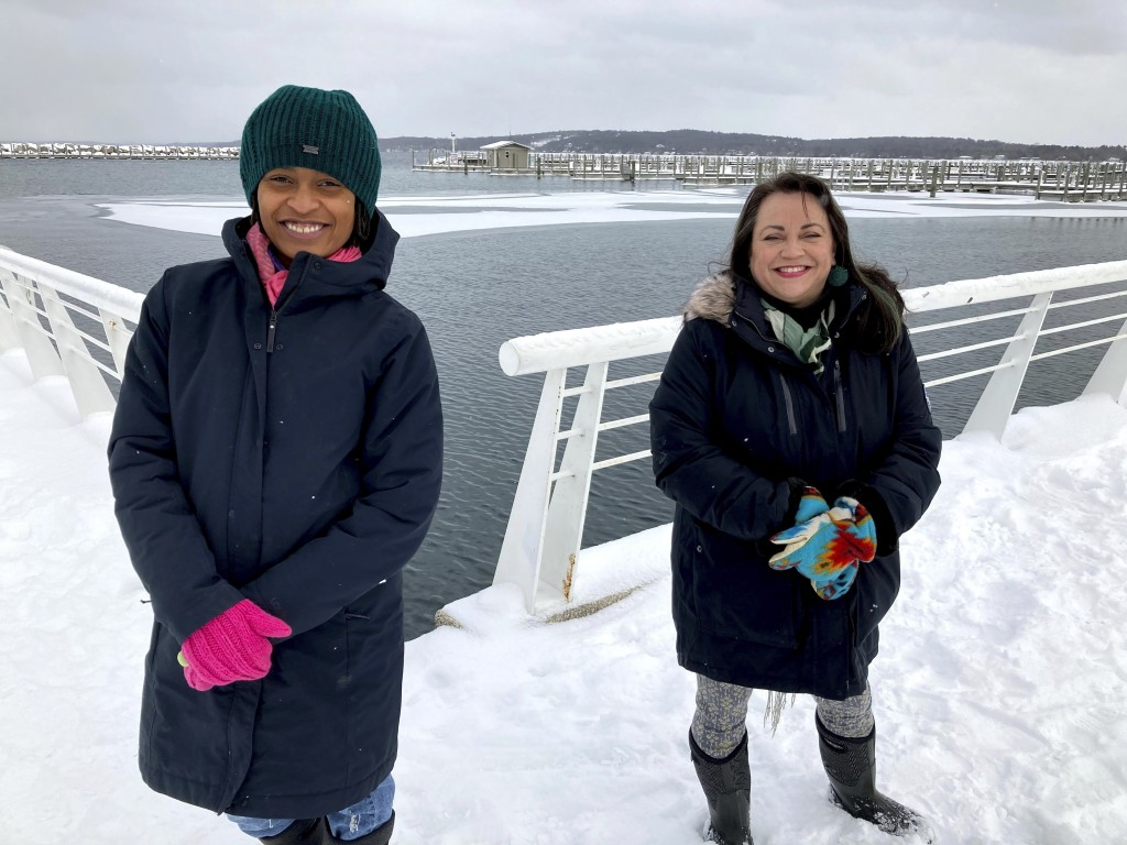Activists Tyasha Harrison, left, and Holly T. Bird pose along the Grand Traverse Bay waterfront in Traverse City, Mich., Feb. 13, 2021. They are among...