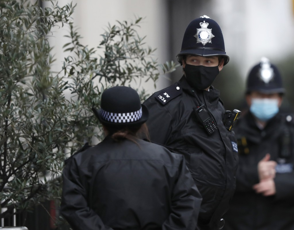 Police stand guard outside the King Edward VII hospital In London, Monday, Feb. 22, 2021, where Britain's Prince Philip is being treated. Prince Phili...