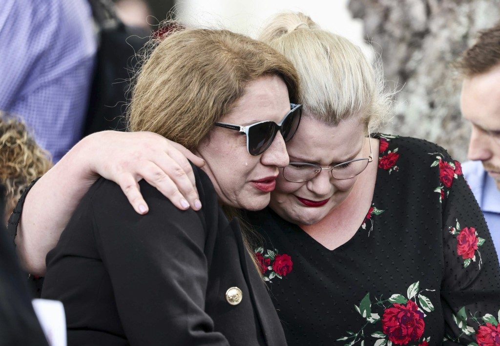 Two women embrace as they attend the 10th anniversary memorial service of the 2011 Christchurch earthquake in Christchurch, New Zealand, Monday, Feb. ...