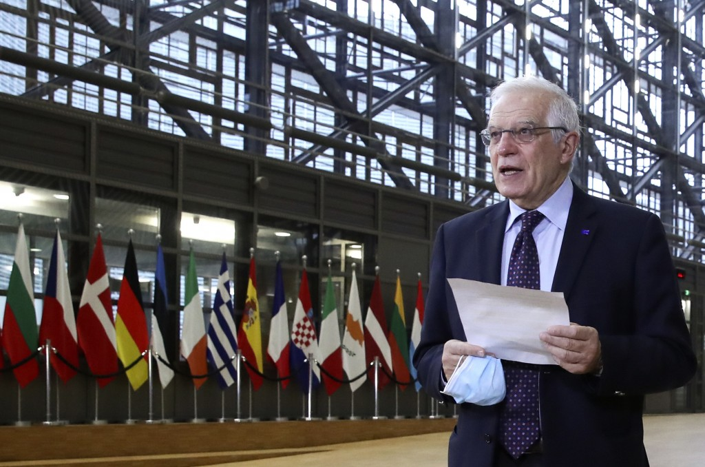 European Union foreign policy chief Josep Borrell speaks to the media as he arrives for a meeting of EU foreign ministers at the European Council buil...