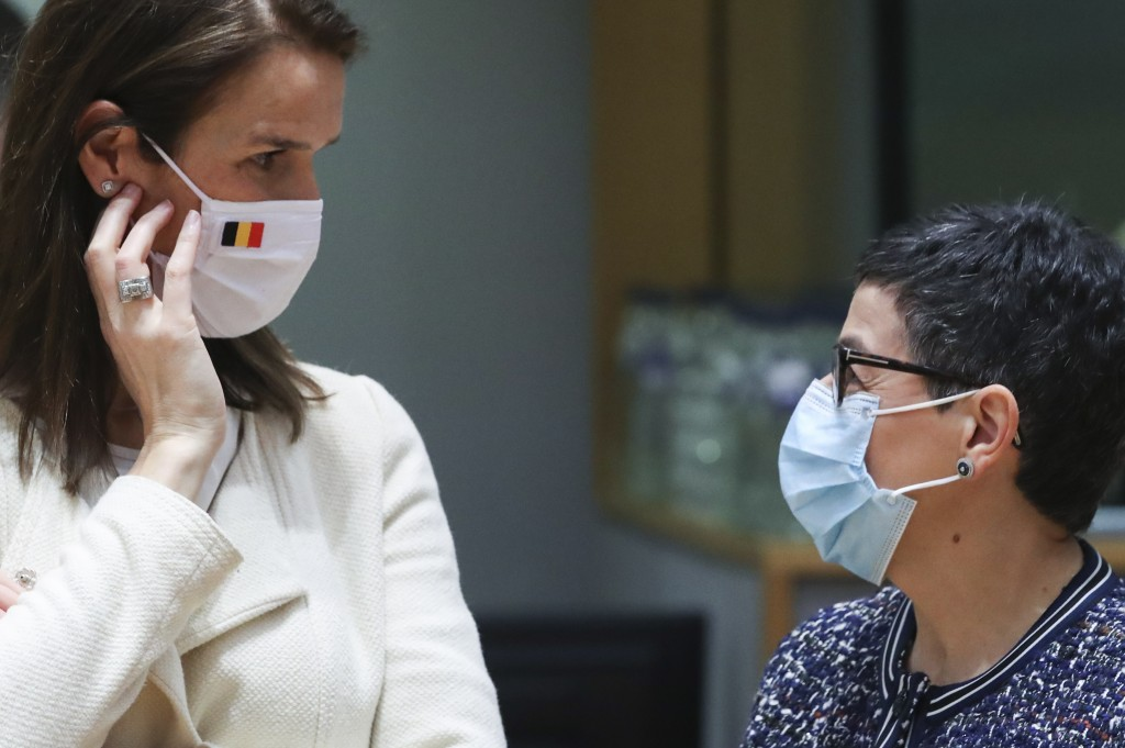 Belgium's Foreign Minister Sophie Wilmes, left, speaks with Spain's Foreign Minister Arancha Gonzalez Laya during a meeting of EU foreign ministers at...