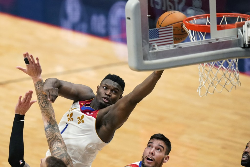 New Orleans Pelicans forward Zion Williamson (1) goes to the basket in the first half of an NBA basketball game against the Boston Celtics in New Orle...