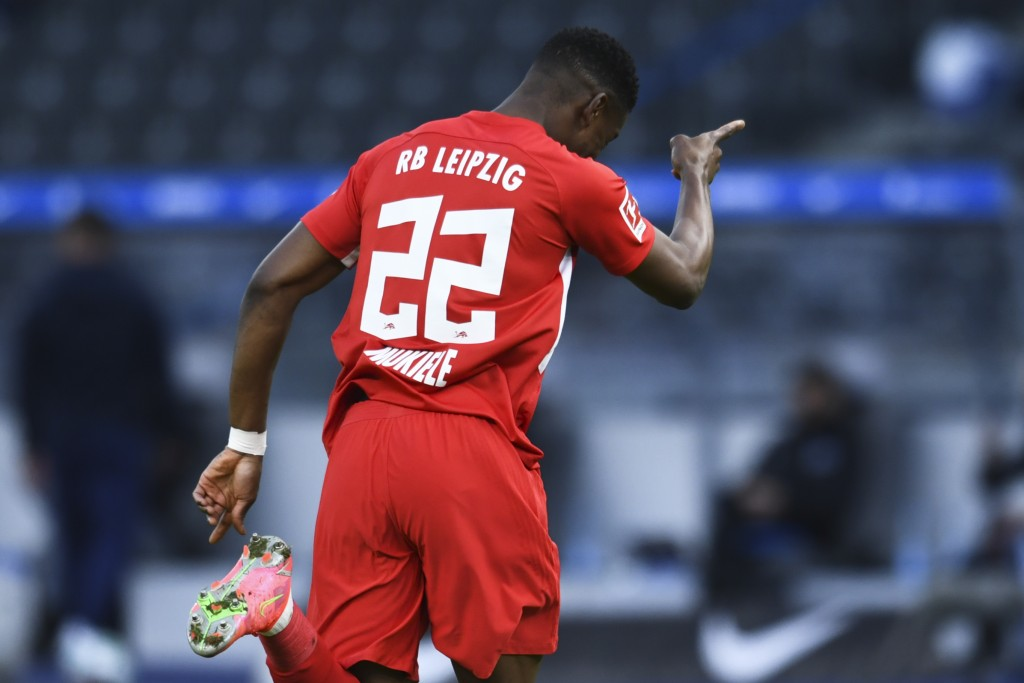 Leipzig's Nordi Mukiele celebrates after scores his side second goal during the German Bundesliga soccer match between Hertha BSC Berlin and RB Leipzi...