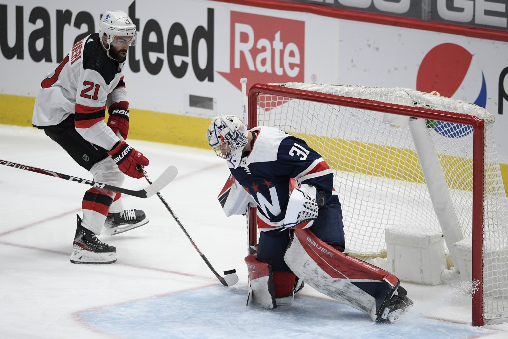 New Jersey Devils right wing Kyle Palmieri (21) skates with the puck towards Washington Capitals goaltender Craig Anderson (31) during the first perio...