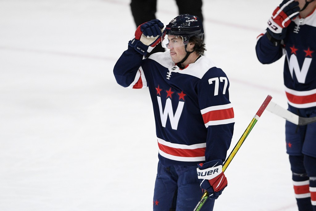 Washington Capitals right wing T.J. Oshie (77) celebrates his goal during the second period of an NHL hockey game against the New Jersey Devils, Sunda...