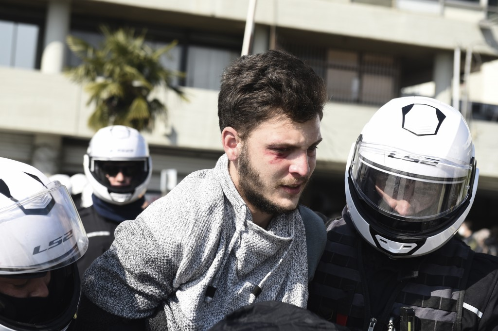 Police detain a protester at the University of Thessaloniki in northern Greece , on Monday, Feb. 22, 2021. Police clashed with protesters and detained...
