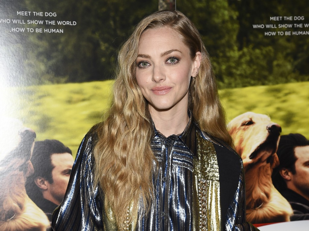 "FILE - Actress Amanda Seyfried attends a special screening of ""The Art of Racing in the Rain"" in New York on Aug. 5, 2019. Seyfried stars in the David..."