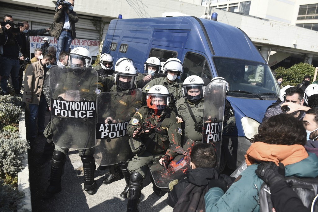 Police clash with protesters at the University of Thessaloniki in northern Greece, on Monday, Feb. 22, 2021. Police clashed with protesters and detain...